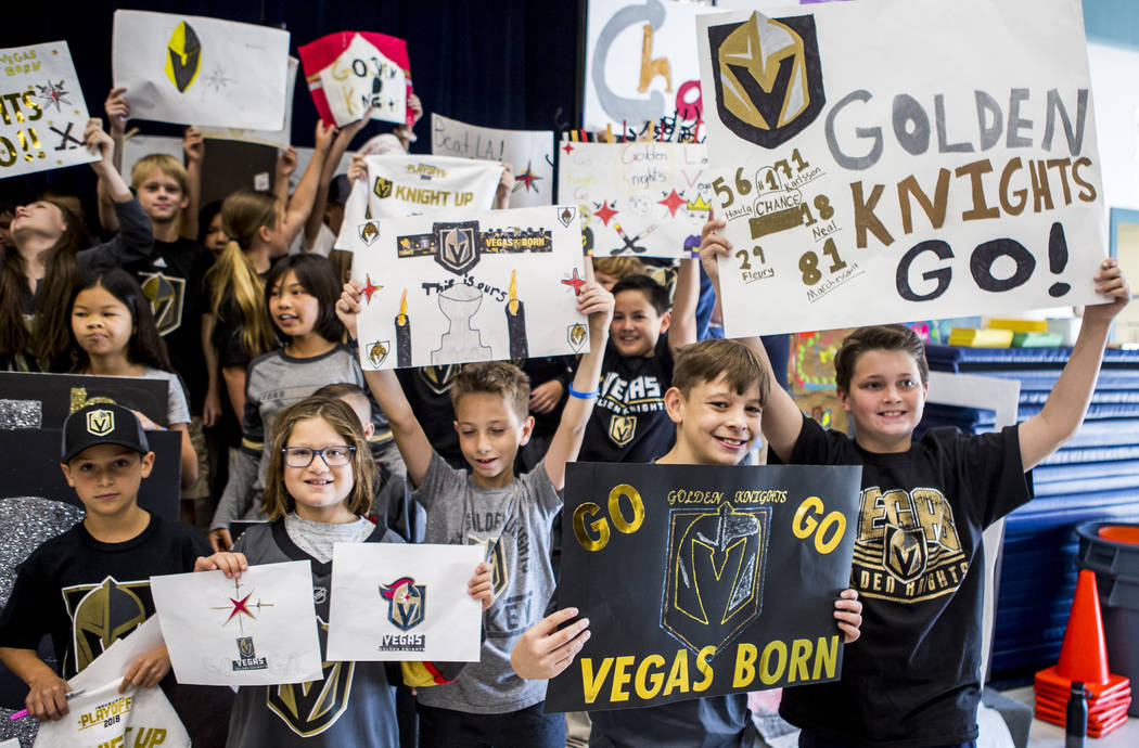Fourth and fifth graders hold up signs the made for a Golden Knights pep rally at John C. Vanderburg Elementary School in Henderson on Tuesday, April 17, 2018. Patrick Connolly Las Vegas Review- ...