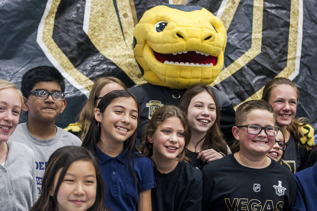 Vegas Golden Knights mascot Chance the Gila monster has photos taken with elementary schoolers during a Golden Knights pep rally for fourth and fifth graders at John C. Vanderburg Elementary Schoo ...