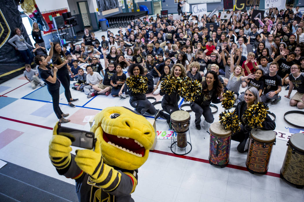 Vegas Golden Knights mascot Chance the Gila monster takes a selfie with the crowd during a Golden Knights pep rally for fourth and fifth graders at John C. Vanderburg Elementary School in Henderso ...