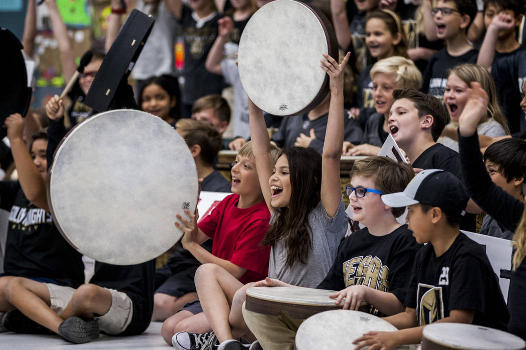 Members of the choir and instrument ensemble perform an original song about the Golden Knights during a Golden Knights pep rally for fourth and fifth graders at John C. Vanderburg Elementary Schoo ...