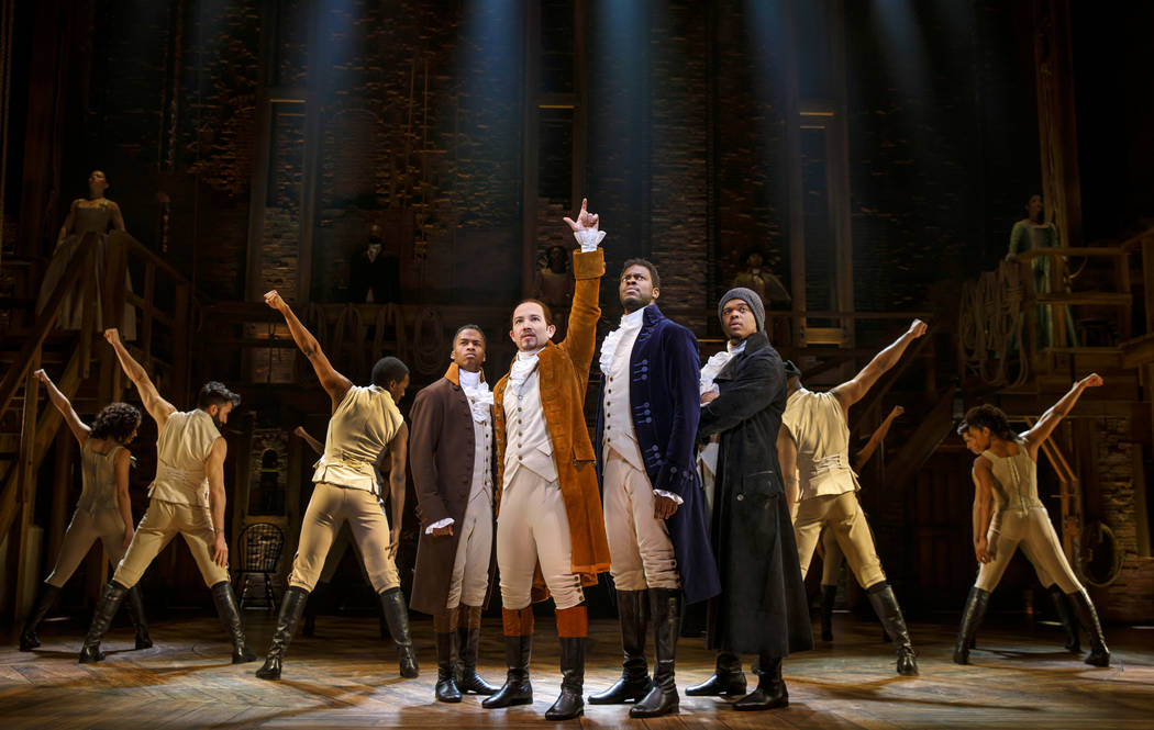 "Joseph Morales, center, as Alexander Hamilton, in the national touring company of ""Hamilton,"" playing The Smith Center May 29-June 24."