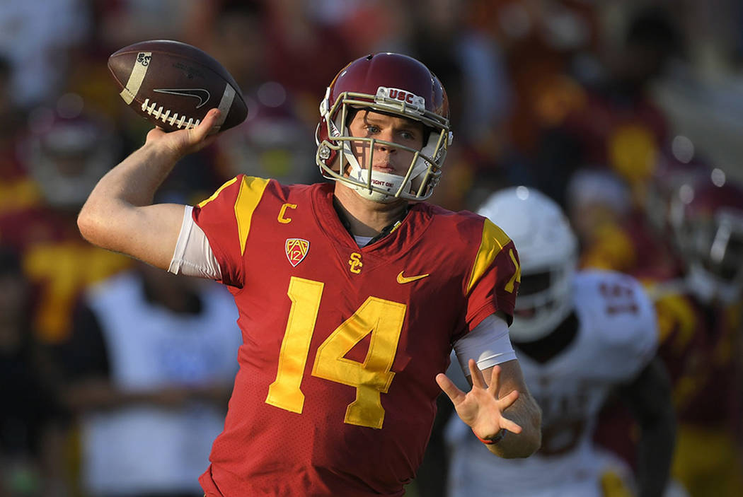 Southern California quarterback Sam Darnold throws during the first half of an NCAA college football game against Texas, in Los Angeles in 2017. (AP Photo/Mark J. Terrill, File)