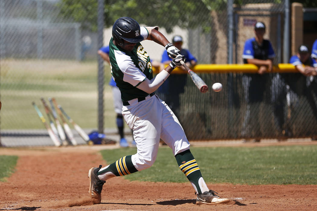 Rancho's shortstop Edarian Williams (32) swings against Basic at Rancho High School in Las Vegas on Saturday, April 7, 2018. Rancho won 16-4. Andrea Cornejo Las Vegas Review-Journal @dreacornejo