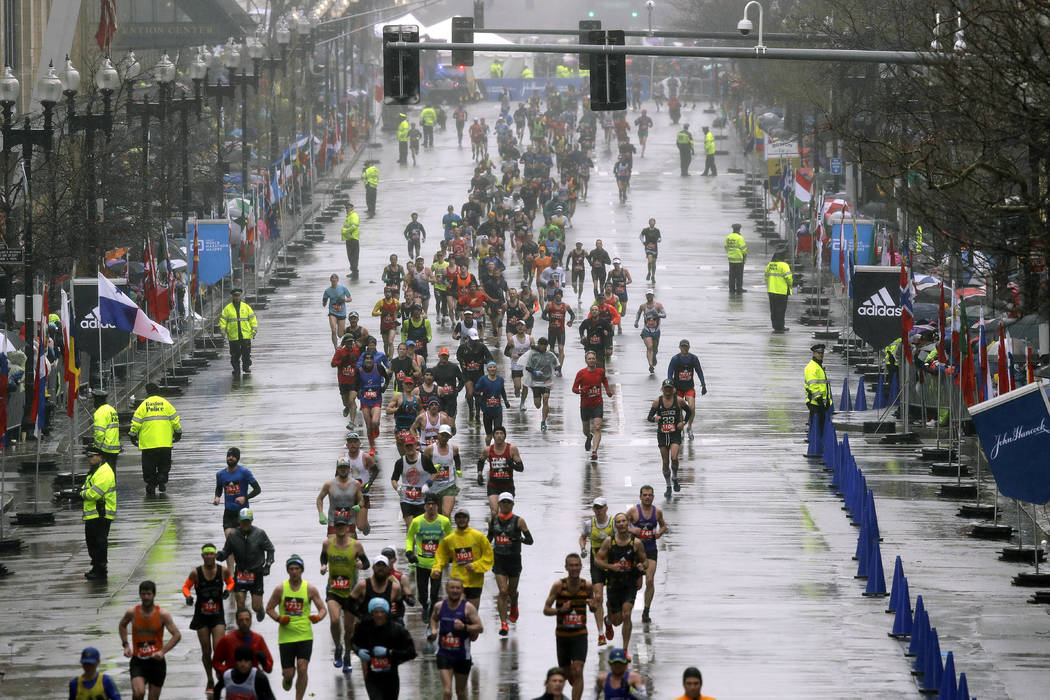 Runners approach the finish line during the 122nd Boston Marathon on Monday, April 16, 2018, in Boston. (AP Photo/Charles Krupa)