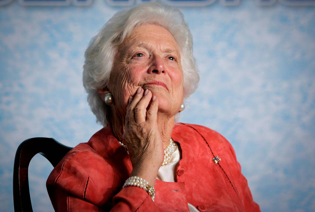 In this file photo from Friday, March 18, 2005, former first lady Barbara Bush listens to her son, President George W. Bush, as he speaks on Social Security reform in Orlando, Fla. The wife of for ...