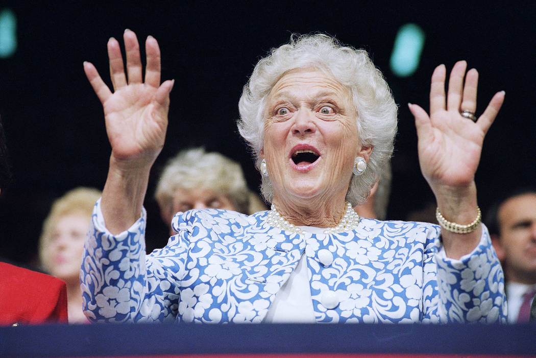 First Lady Barbara Bush reacts to Sen. Phil Gramm, who delivered the keynote address to the Republican National Convention at the Houston Astrodome, Tuesday, Aug. 18, 1992, Houston, Tex. Gramm der ...