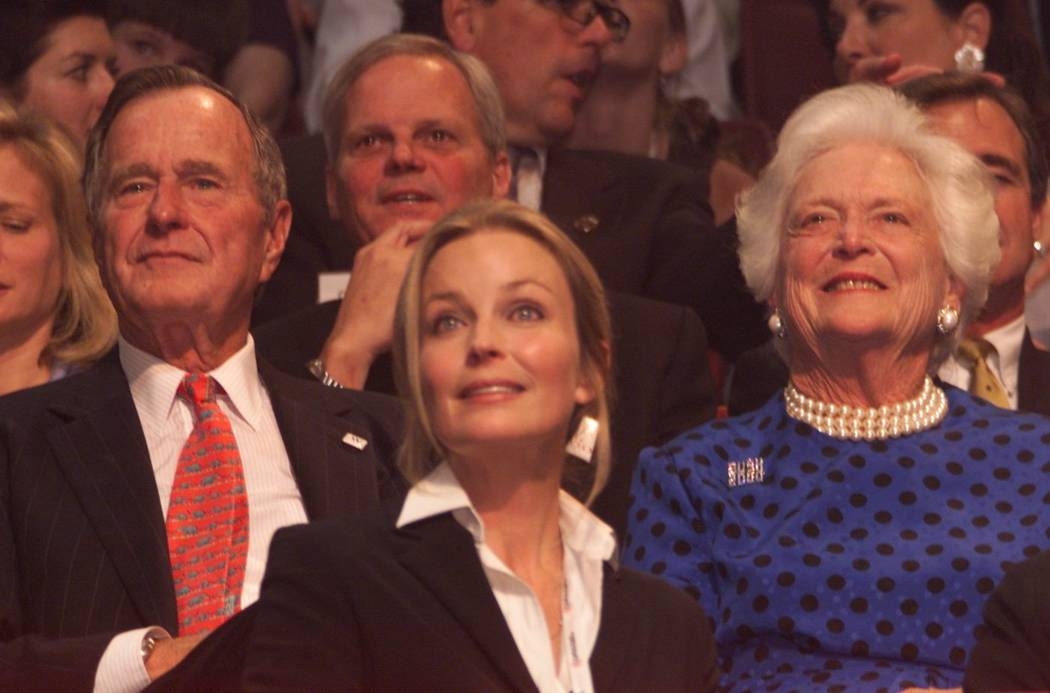 NEWS Bo Derrick sits in the VIP booth with George and Barbara Bush on Wednesday night. photo by jeff scheid