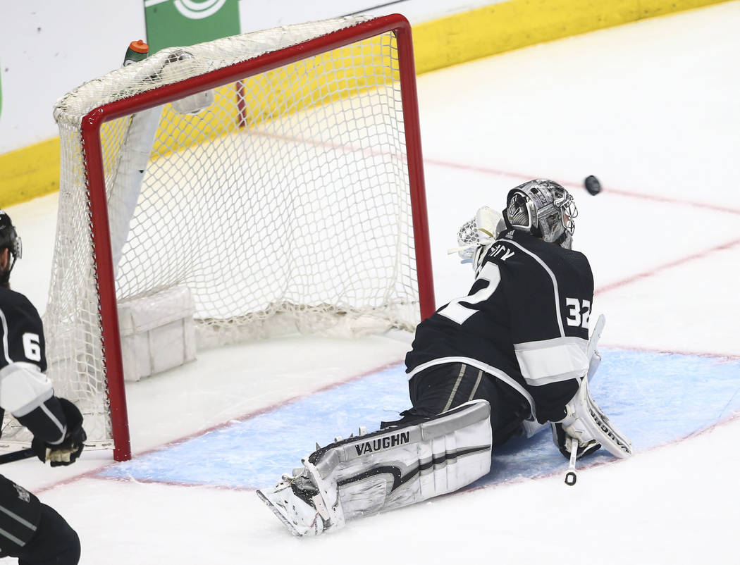 Los Angeles Kings goaltender Jonathan Quick (32) gets scored on by Golden Knights defenseman Brayden McNabb, not pictured, during the second period of Game 4 of an NHL hockey first-round playoff s ...