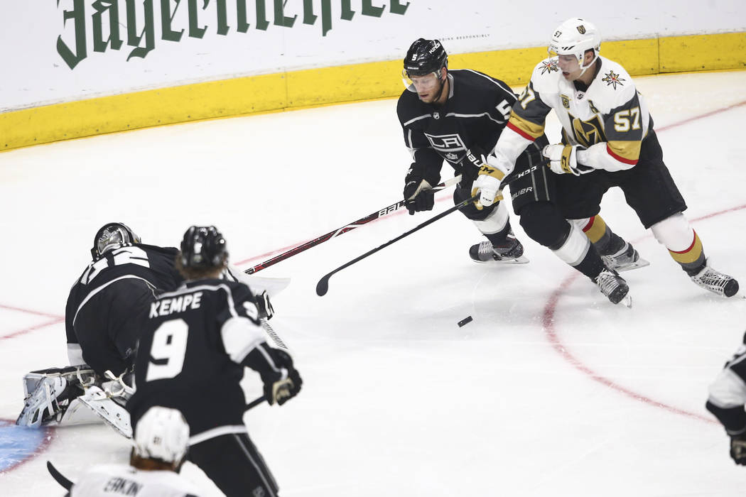 Golden Knights left wing David Perron (57) controls the puck as Los Angeles Kings defenseman Christian Folin (5) defends during the second period of Game 4 of an NHL hockey first-round playoff ser ...