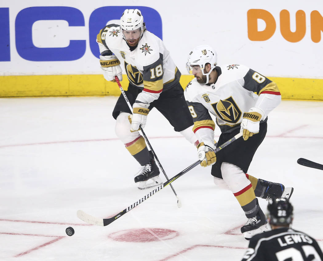Golden Knights right wing Alex Tuch (89) moves the puck as Golden Knights left wing James Neal (18) looks on during the second period of Game 4 of an NHL hockey first-round playoff series against ...
