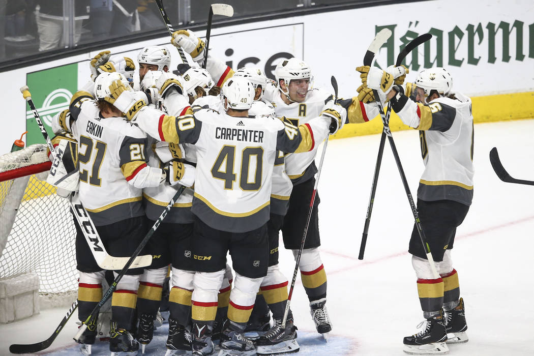 Golden Knights players celebrate after defeating the Los Angeles Kings 1-0 in Game 4 of an NHL hockey first-round playoff series at the Staples Center in Los Angeles on Tuesday, April 17, 2018. Ch ...