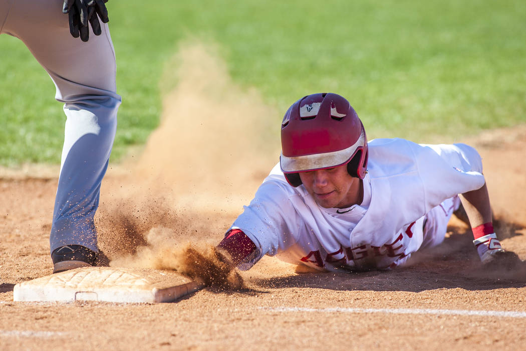Arbor View's Tyler Whitaker slides in safe at first during the second inning while playing against Faith Lutheran at Arbor View High School in Las Vegas on Tuesday, April 17, 2018. Arbor View won ...