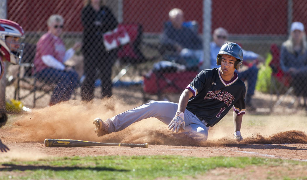 Faith Lutheran outfielder Dylan Schafer slides in safe at home during the third inning at Arbor View High School in Las Vegas on Tuesday, April 17, 2018. Arbor View won 11-5. Patrick Connolly La ...