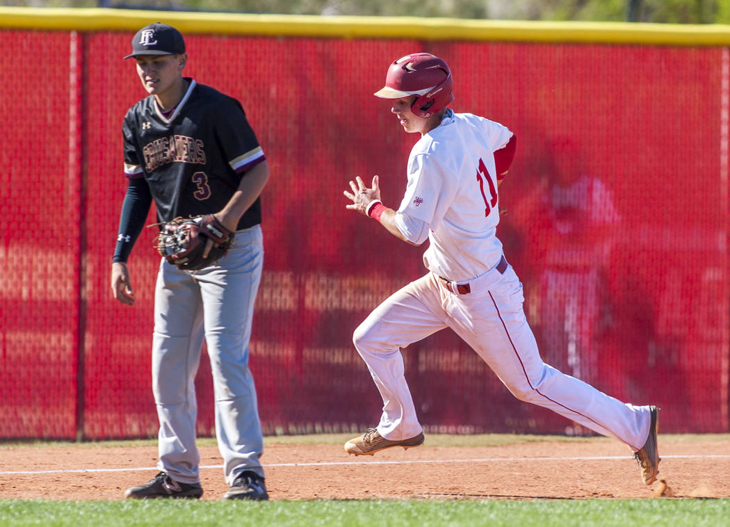 Arbor View's Tyler Whitaker rounds third base while Faith Lutheran infielder Dominic Clayton stands by in the third inning at Arbor View High School in Las Vegas on Tuesday, April 17, 2018. Arbor ...
