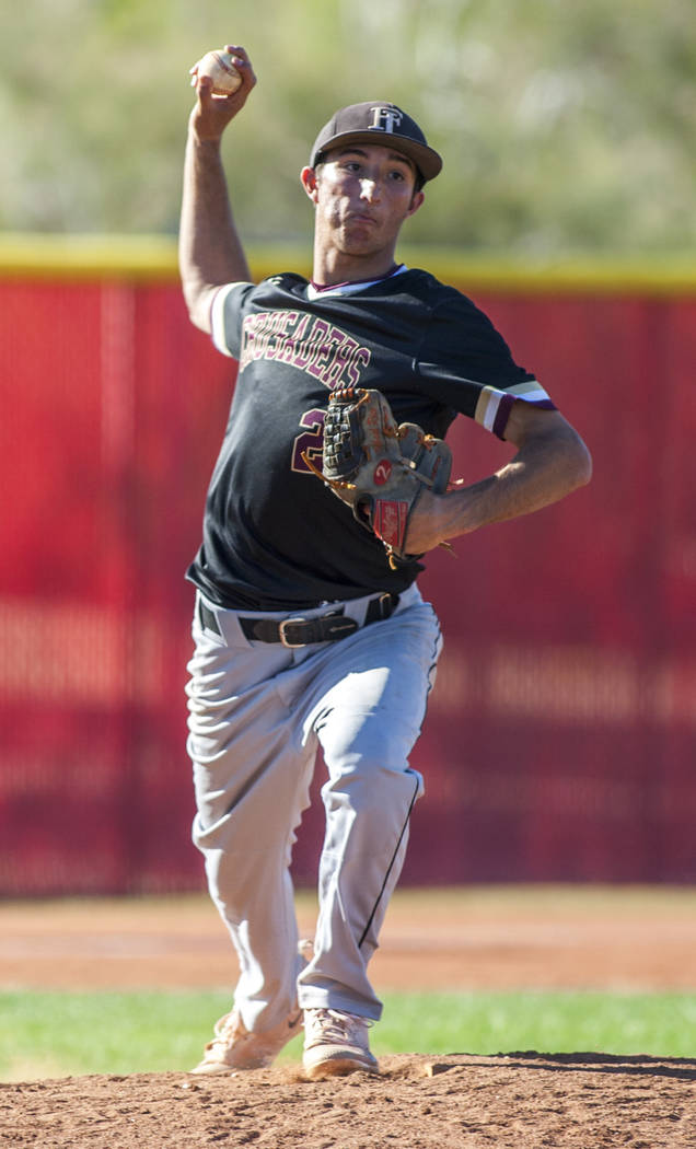 Faith Lutheran pitcher Michael Rice looks for a play at first base while playing against Arbor View in the fifth inning at Arbor View High School in Las Vegas on Tuesday, April 17, 2018. Arbor Vie ...