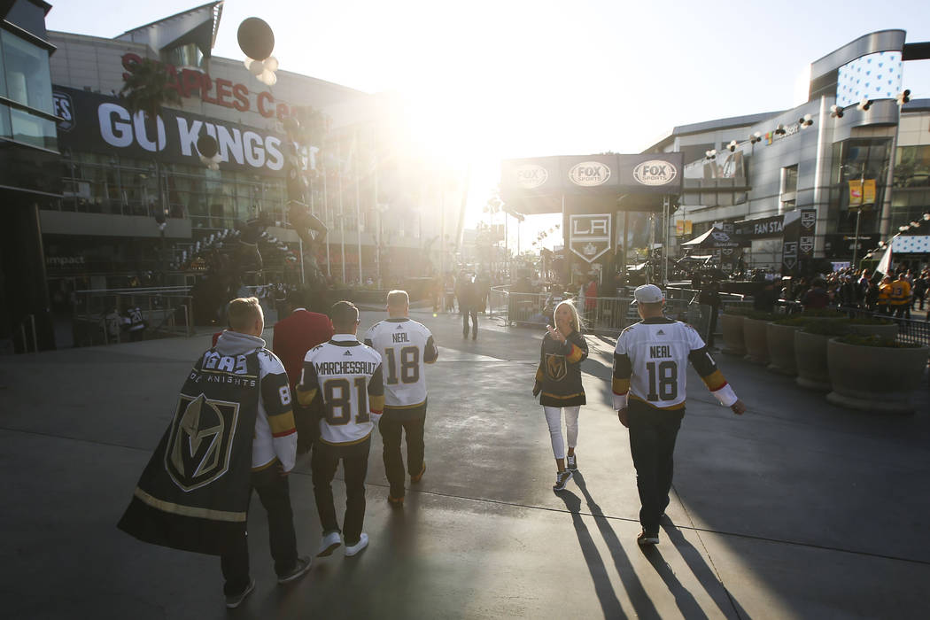 Golden Knights fans make their way to the Staples Center ahead of Game 4 of an NHL hockey first-round playoff series against the Los Angeles Kings on Tuesday, April 17, 2018. Chase Stevens Las Veg ...