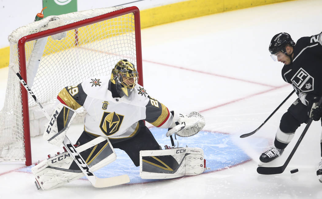 Los Angeles Kings right wing Dustin Brown (23) attempts to score against Golden Knights goaltender Marc-Andre Fleury (29) during the first period of Game 4 of an NHL hockey first-round playoff ser ...