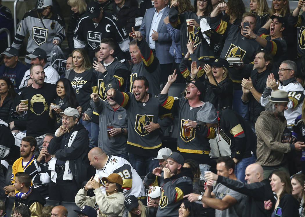 Golden Knights fans celebrate a goal by defenseman Brayden McNabb, not pictured, during the second period of Game 4 of an NHL hockey first-round playoff series against the Los Angeles Kings at the ...