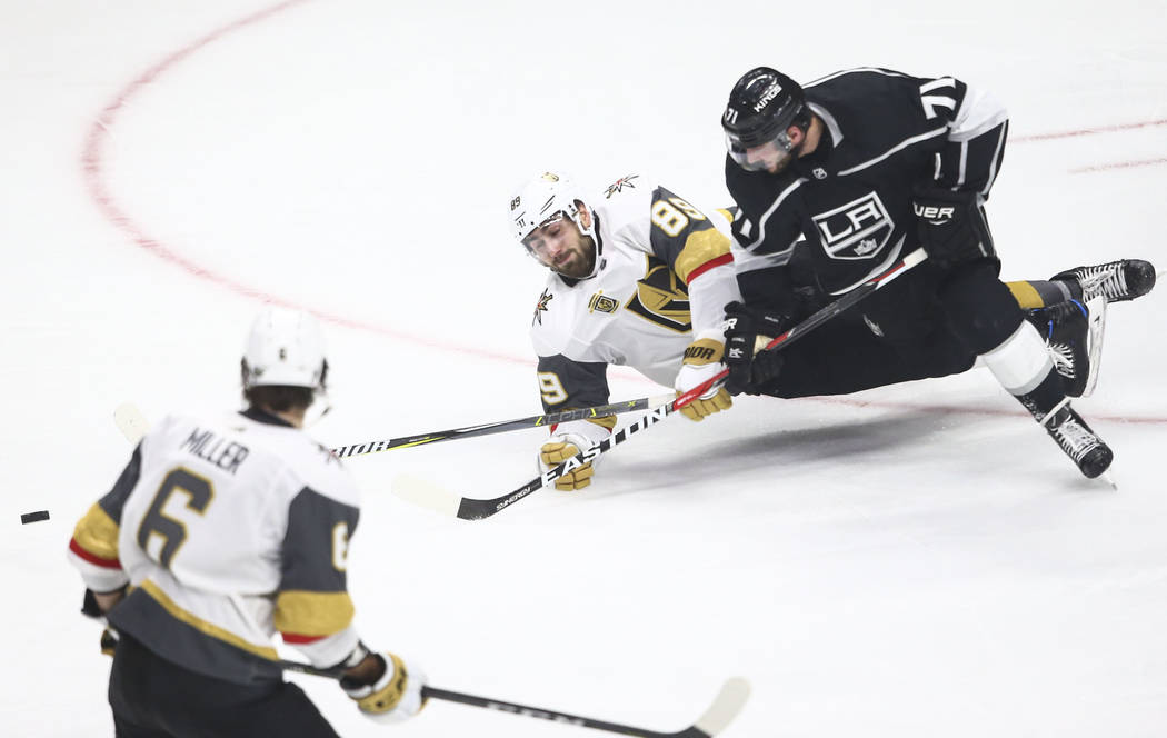 Golden Knights right wing Alex Tuch (89) and Los Angeles Kings center Torrey Mitchell (71) fall to the ice during the second period of Game 4 of an NHL hockey first-round playoff series at the Sta ...
