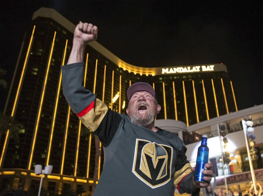 Golden Knights fan Jerry Norskog pumps his fist in the air after Vegas scored a second period goal against the Los Angeles Kings during a watch party at the Mandalay Bay hotel-casino on Tuesday, A ...