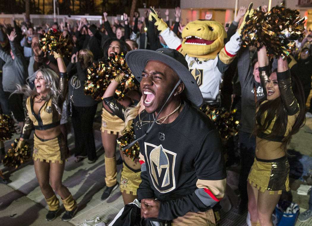 Golden Knights fan Deanthony Carson celebrates at a watch party at the Mandalay Bay hotel-casino after Vegas defeated the Los Angeles Kings 1-0 to complete the four game sweep to advance to the se ...