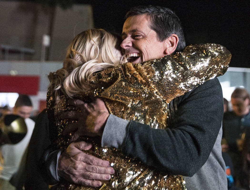 Golden Knights fans Brandon Potts, right, hugs Shannon Boyd at a watch party at the Mandalay Bay hotel-casino after Vegas defeated the Los Angeles Kings 1-0 to complete the four game sweep to adva ...