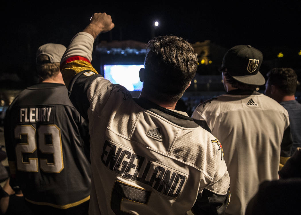 Golden Knights fans celebrate at a watch party at the Mandalay Bay hotel-casino after Vegas defeated the Los Angeles Kings 1-0 to complete the four game sweep to advance to the second round of the ...