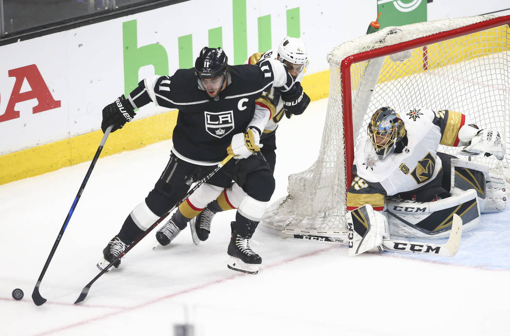Los Angeles Kings center Anze Kopitar (11) controls the puck as Golden Knights left wing Pierre-Edouard Bellemare (41) and goaltender Marc-Andre Fleury (29) defend during the first period of Game ...