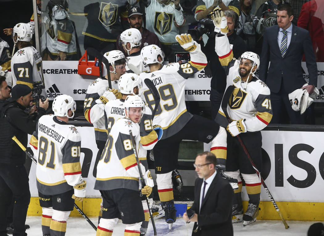 Golden Knights left wing Pierre-Edouard Bellemare (41) high-fives right wing Alex Tuch (89) after defeating the Los Angeles Kings 1-0 in Game 4 of an NHL hockey first-round playoff series at the S ...