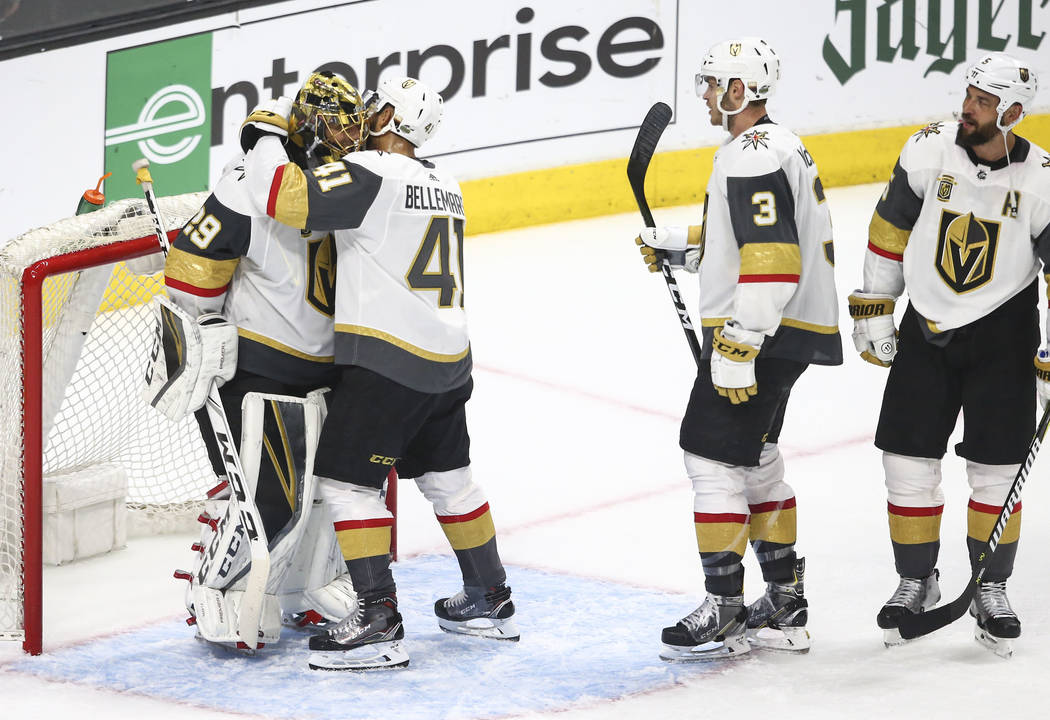 Golden Knights left wing Pierre-Edouard Bellemare (41) hugs goaltender Marc-Andre Fleury (29) after defeating the Los Angeles Kings 1-0 in Game 4 of an NHL hockey first-round playoff series at the ...