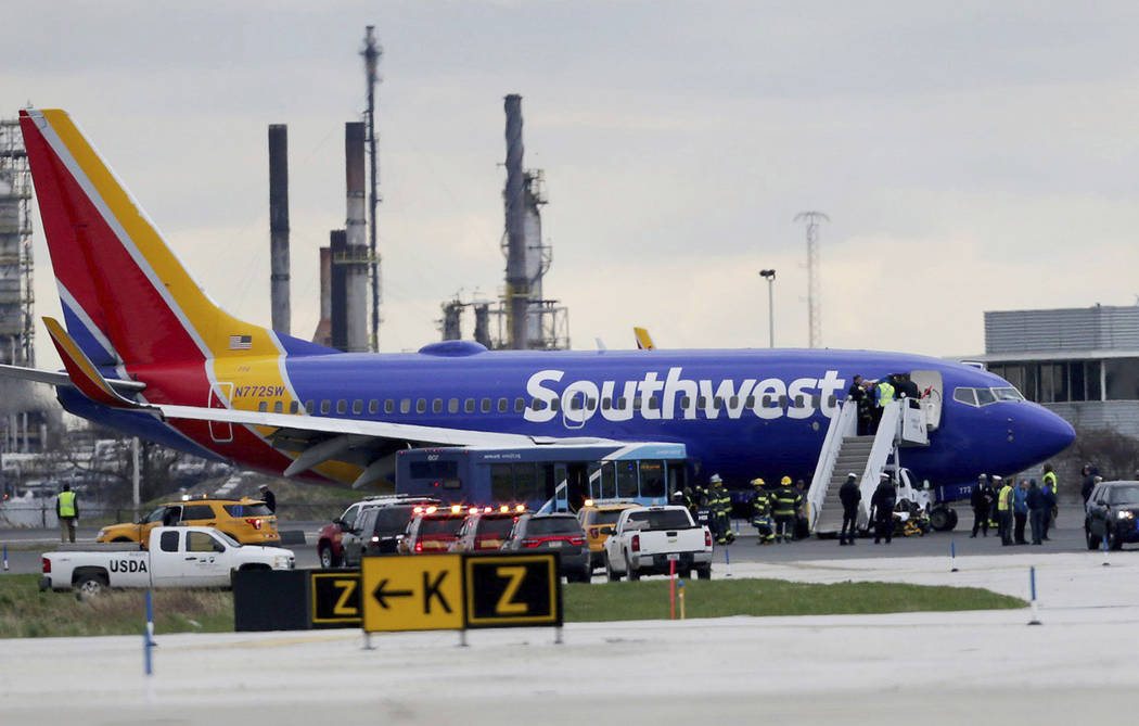 A Southwest Airlines plane sits on the runway at the Philadelphia International Airport after it made an emergency landing in Philadelphia, on Tuesday, April 17, 2018. (David Maialetti/The Philade ...