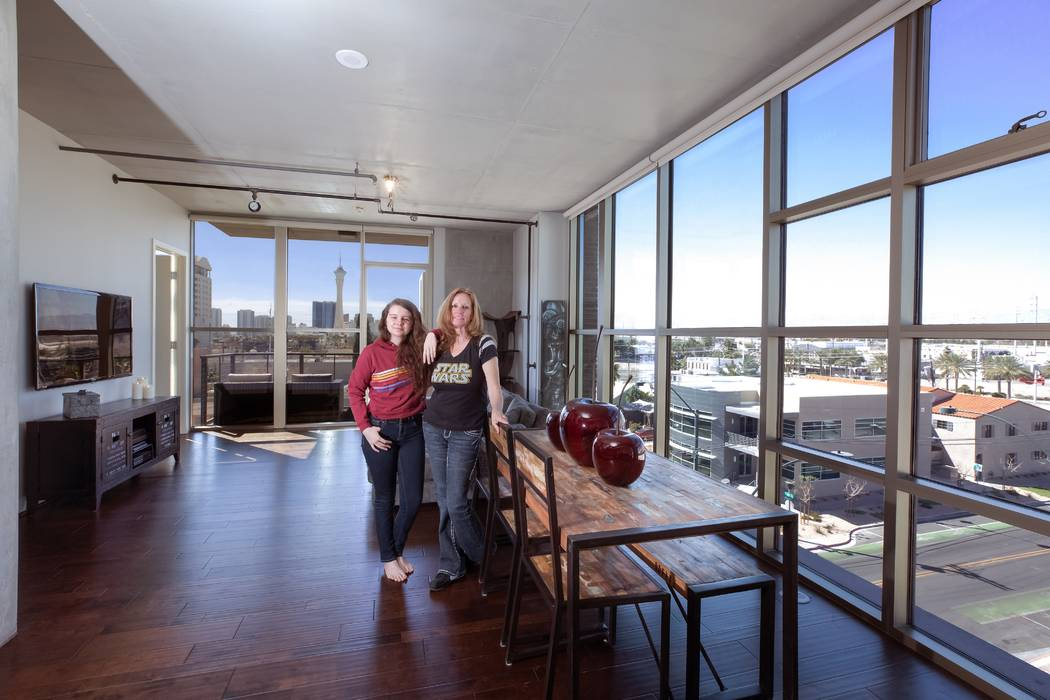Karen Alexander and her daughter, Rebecca, relax in the Juhl high-rise unit their family recently purchased. (Juhl)