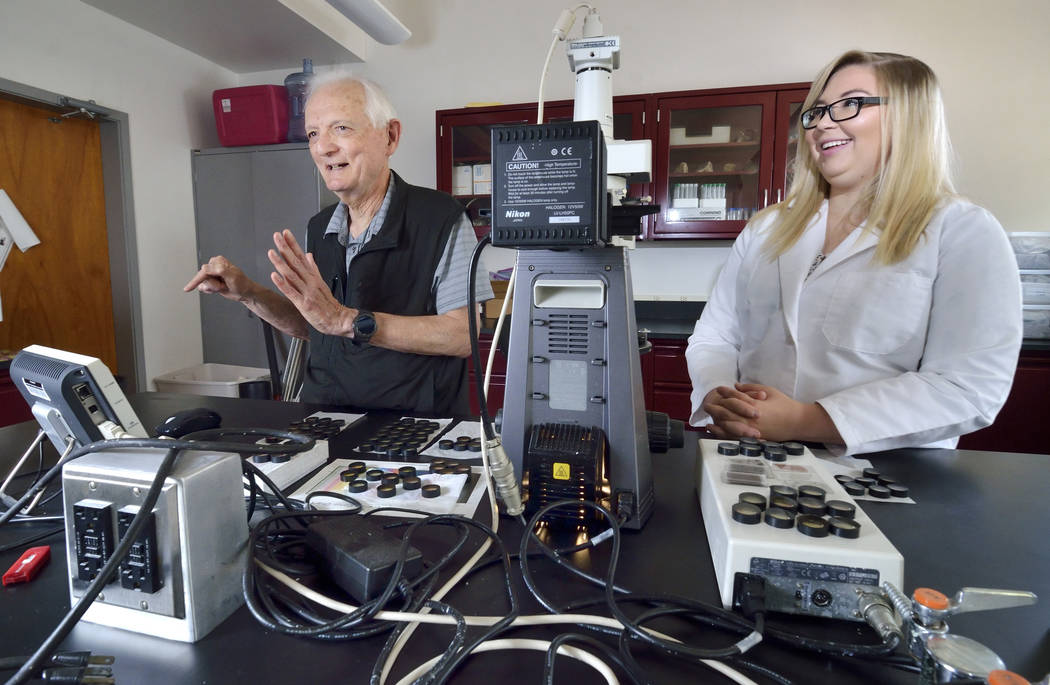 Eugene Smith, professor emeritus of geology at UNLV, left, is shown with senior geology major Shelby Fitch in the cryptotephra lab on the university campus at 4505 S. Maryland Parkway in Las Vegas ...