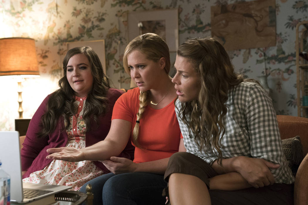 Aidy Bryant, Amy Schumer, and Busy Phillips star in I FEEL PRETTY (Photo Credit: Mark Schafer; Motion Picture Artwork © 2017 STX Financing,)