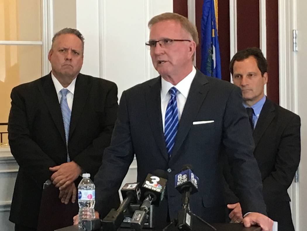 Las Vegas attorney Robert Eglet speaks to reporters about a class-action lawsuit against bump stock manufacturer Slide Fire Solutions, LP. Behind Eglet are attorney Robert Adams, left, of Eglet Pr ...