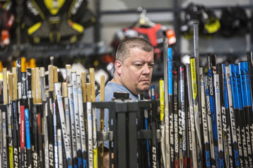 "John Gutierrez looks at hockey sticks on Wednesday, April 18, 2018, at The Arsenal, in Las Vegas. ""I thought it might be fun to bring one of these to the Knights games,"" said Gutierrez. ..."