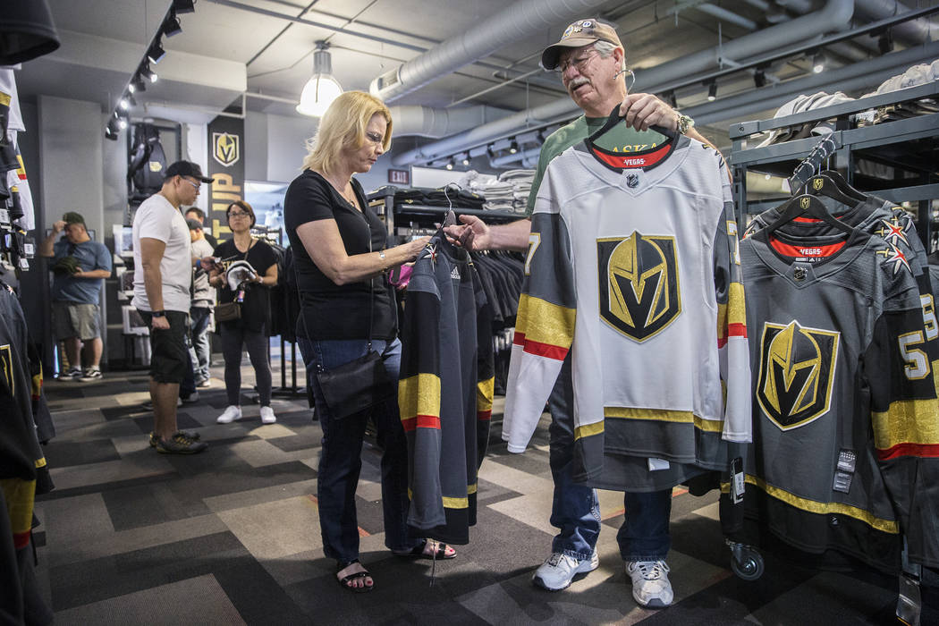 "Charmaine Pennington, left, and husband Tom shop for Golden Knights jerseys on Wednesday, April 18, 2018, at The Arsenal, in Las Vegas. ""We're buying one for our son who's in the Air Force in ..."