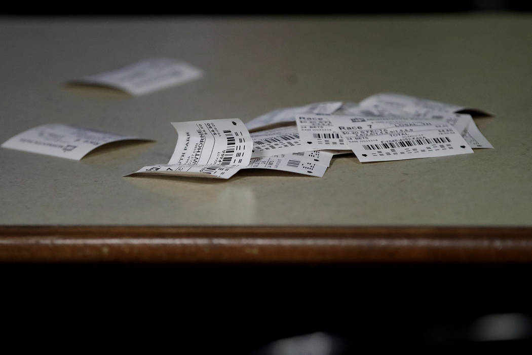 In this Nov. 30, 2017, photo, betting slips are seen on a table at the Monmouth Park racetrack in West Long Branch, N.J. With banks of TVs tuned to all-sports stations and a spacious bar, the loun ...