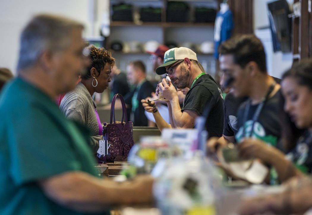 Customers check out cannabis products at Nuwu Cannabis Marketplace on Friday, April 23, 2018. Patrick Connolly Las Vegas Review-Journal @PConnPie