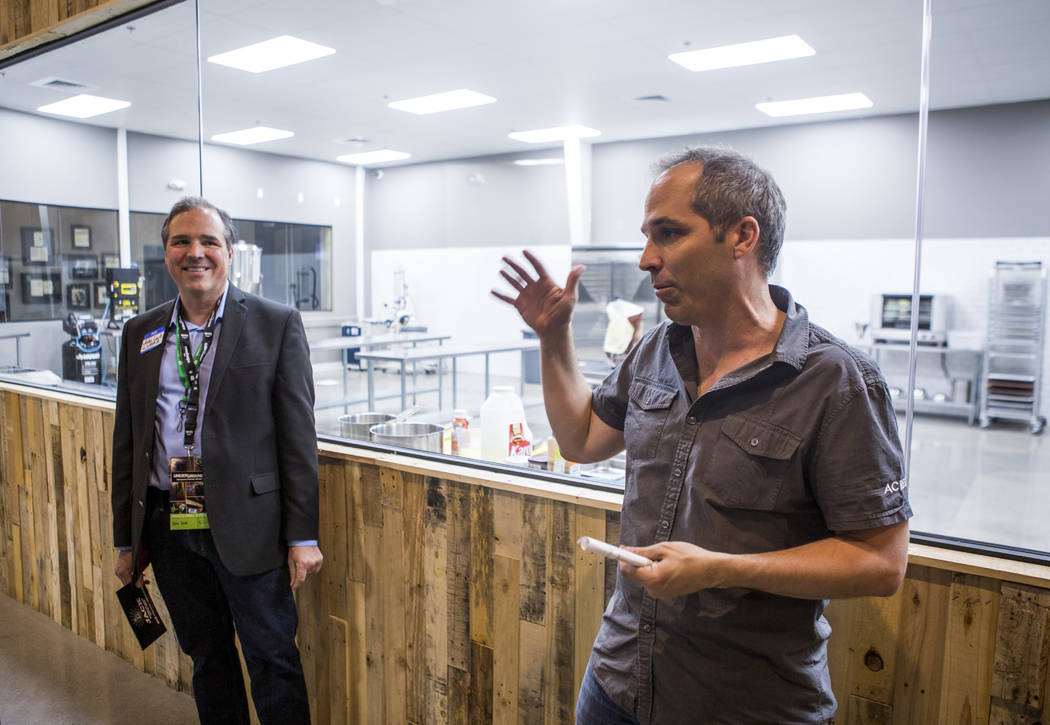 John Mueller, founder and CEO of Acres Dispensary, talks about the dispensary's new cannabis kitchen while John Laub, president of the Las Vegas Medical Marijuana Association, listens in the backg ...