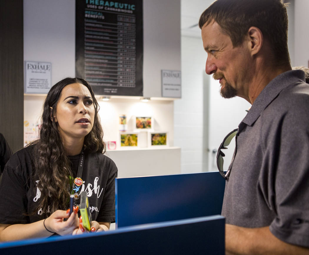 Alyssa Jusino helps Michael Brousseau of New Mexico pick out a product for vaping at Exhale Nevada on Friday, April 23, 2018. Patrick Connolly Las Vegas Review-Journal @PConnPie