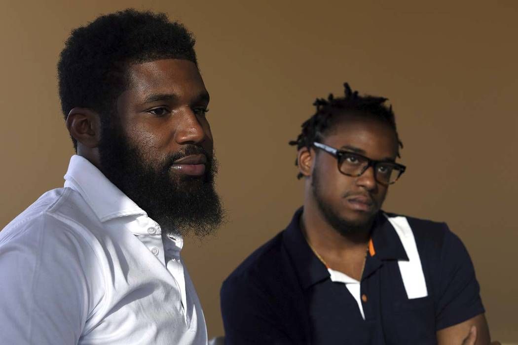 In this Wednesday, April 18, 2018 photo, Rashon Nelson, left, and Donte Robinson, right, talk about the day they were arrested at a Philadelphia Starbucks. (Jacqueline Larma/AP)