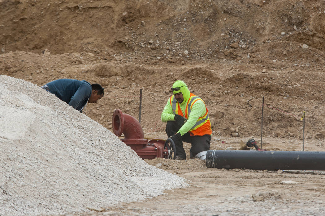 Construction works at the site of the world's largest Chevron and travel center, including 96 gas pumps and totaling 50,000 square feet, in Jean near Interstate 15 on Thursday, April 19, 2018. P ...