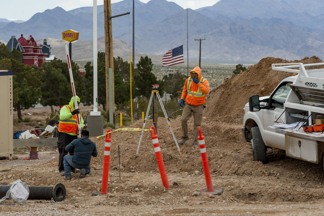 Construction workers at the site of the world's largest Chevron and travel center, including 96 gas pumps and totaling 50,000 square feet, in Jean near Interstate 15 on Thursday, April 19, 2018. ...