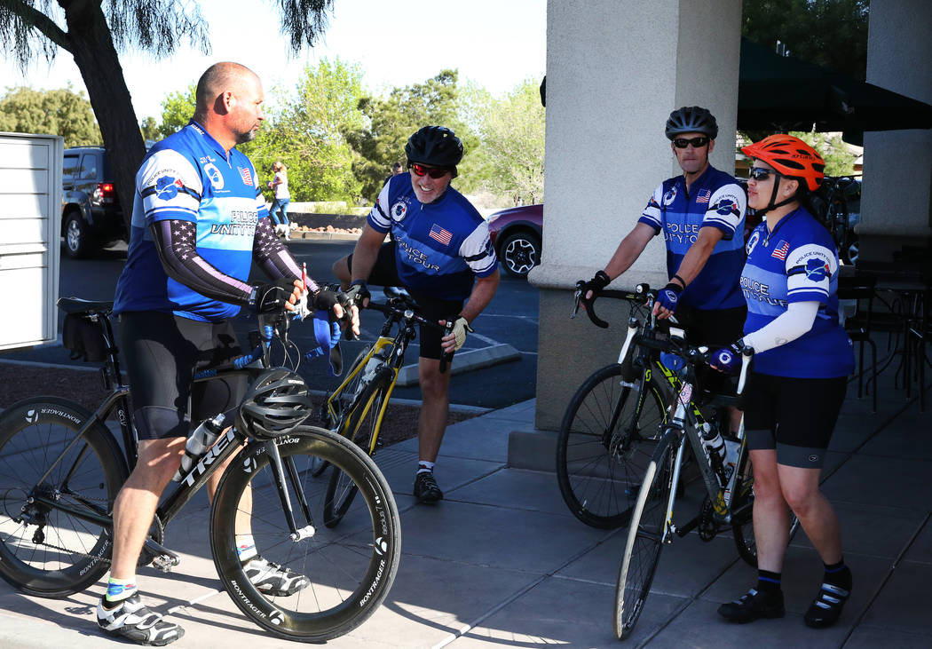Retired Metropolitan Police Department Sgt. Tom Wagner, left, retired Metro Lt. Leonard Marshall, Metro police officer Tyler Todd, Metro detective, Rachel Calderon, right, prepare to ride the ...