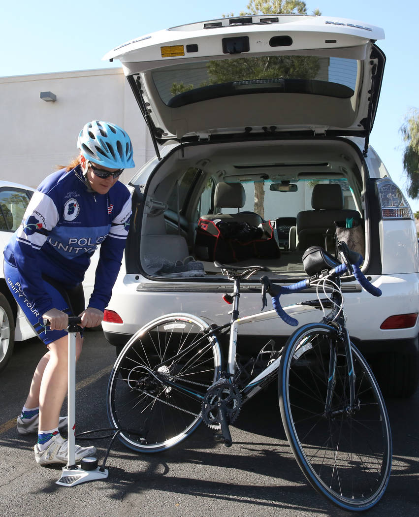 Henderson police officer, Nicole Guess, pumps up her bike tires before the Vegas Team's last practice rides on Friday, April 20, 2018, in Henderson. Guess will ride the Police Unity Tour from New ...