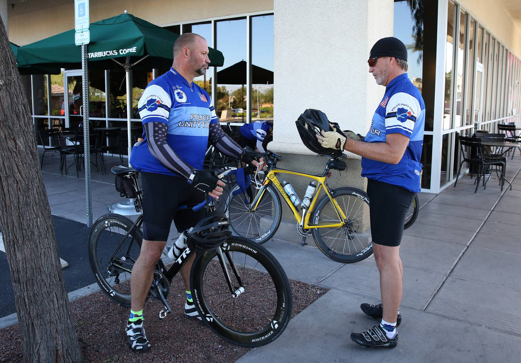 Retired Metropolitan Police Department Sgt. Tom Wagner, left, and retired Metro Lt. Leonard Marshall, prepare to ride their bikes during the Vegas Team's last practice rides on Friday, April ...