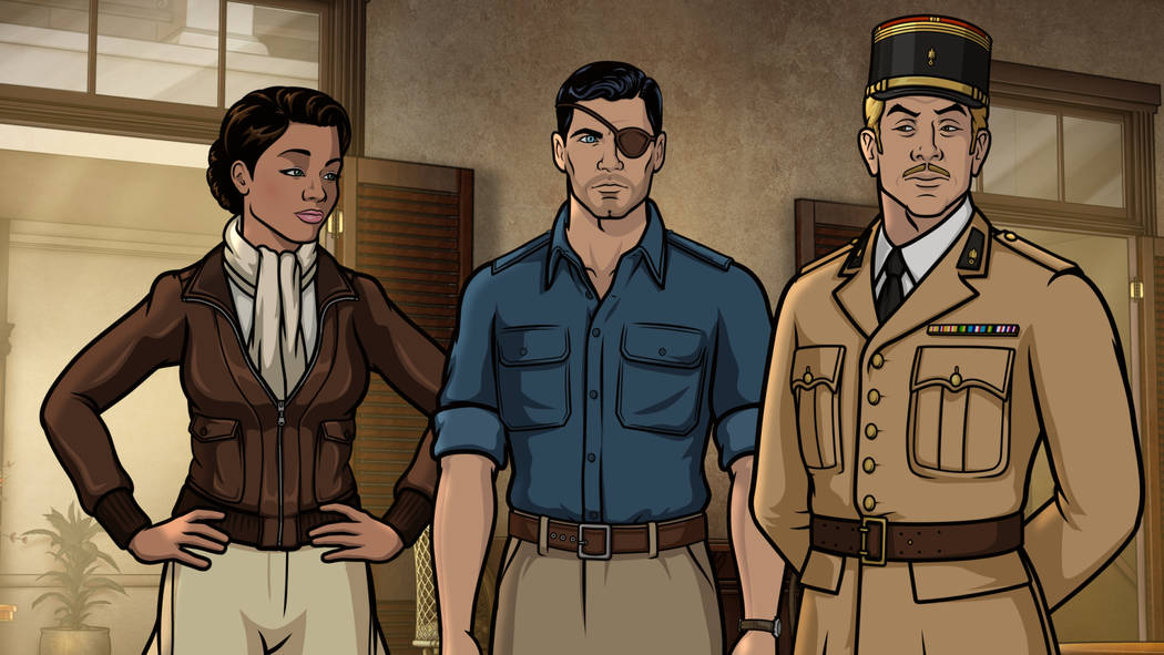 "ARCHER -- ""Season 9, Episode 1 -- Pictured (l-r): Princess Lanaluakalani (voice of Aisha Tyler), Sterling Archer (voice of H. Jon Benjamin), Reynaud (voice of Adam Reed). CR: FXX"