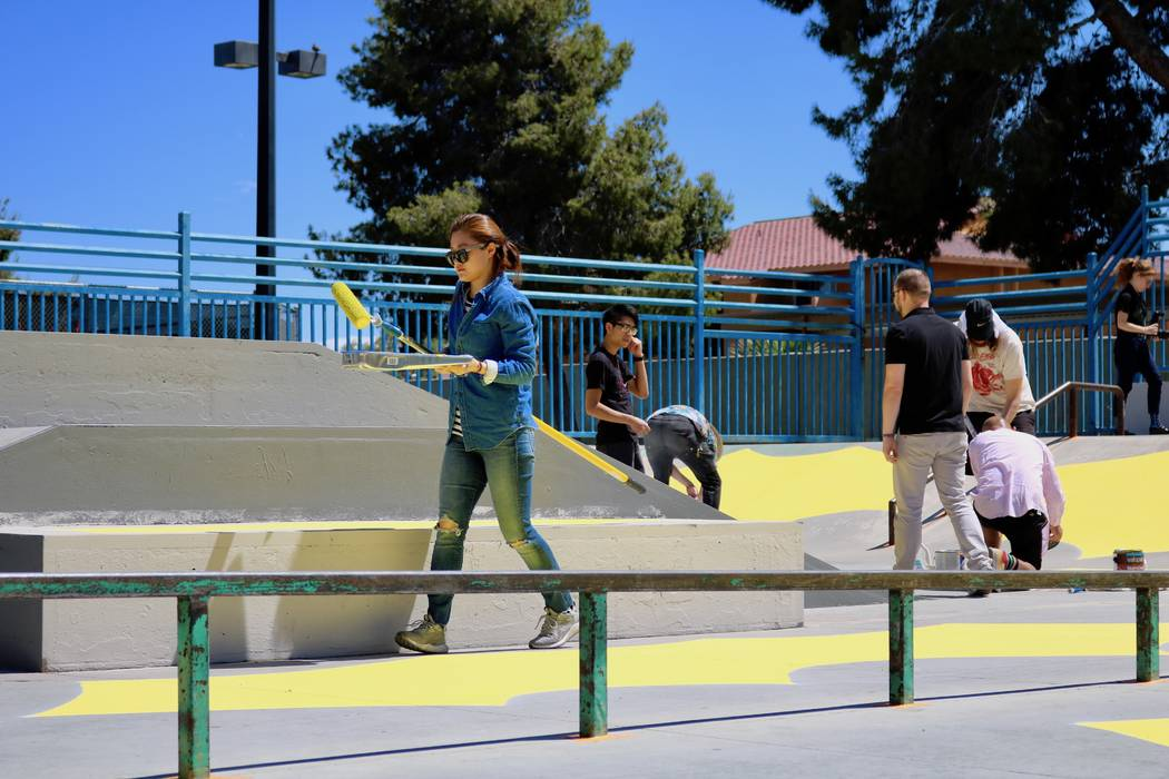 Volunteer artists help paint the skatepark at Winchester Cultural Center Tuesday, April 17, 2018. Los Angeles-based artist Andrew Schoultz joined them in advance of his solo installation at the Ma ...