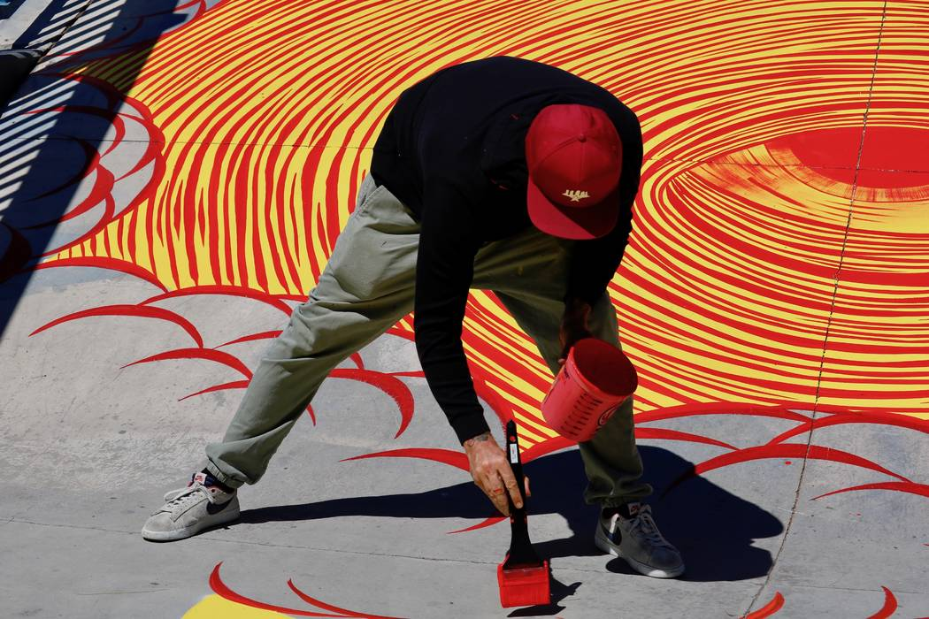 Los Angeles-based artist Andrew Schoultz joined volunteer artists at the skatepark at Winchester Cultural Center Tuesday, April 17, 2018 to paint the park in advance of his solo installation at th ...